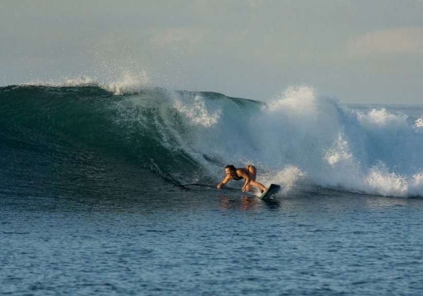 01.-A-little-bit-of-history.-Tenggaras-first-guest-Fiona-Wylde-laying-down-a-seriously-on-edge-bottom-turn-at-Tenggara-Point